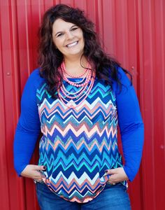 You'll easily fall in love with this Blurred Lines top! An adorable, lightweight top with shades of orange, navy, black, green, teal, purple, and mint throughout the chevron pattern! Our Pink Multi Bubble Gum necklace is the perfect accessory! - http://www.blineboutique.com/product/blurred-lines