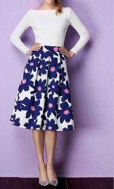 Daisy is a women's high waist floral print pleated midi skirt that fits S to L.
