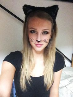 halloween kitty cat costume. cat makeup and cat ears