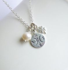 Sterling Silver Good Luck Compass Necklace... Graduation... Journey  https://www.etsy.com/listing/233232788/sterling-silver-compass-lucky-clover-and