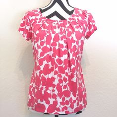 Pink & White Floral Top Silky soft pink & white floral silhouette top. Flattering flowy fit with cute pleating detail around the neck. Very stretchy material. Perfect top for work & casual days! Excellent pre loved condition. Ask any questions! New York & Company Tops Blouses