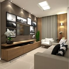 Sala de Tv com quadros na parede e painel madeirado. Super aconchegante e estilosa.
