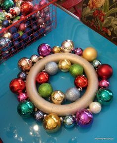 How to make a christmas ornament wreath... Great step by step directions with pictures :) I so want to do this!!!!