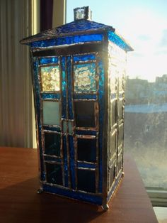 Stained glass Tardis. {She made me a Tardis cake, maybe mom will make me one of these too?!}