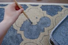 Paint a plain rug to a pattern you like. See Q&A for other tips like sanding afterwards to make softer...