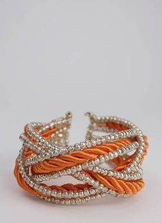orange cord and silver beads