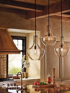Update your kitchen lighting in time to entertain guests. A trio of Kichler glass pendant lights makes a striking focal point.
