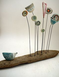 take the cool driftwood with the rock in it, and add a clay crab where bird is(or maybe sand piper?), and seagulls, kites, etc in the air. Ceramic Birds, Ceramic Flowers, Ceramic Clay, Ceramic Pottery, Diy Clay, Clay Crafts, Arts And Crafts, Paper Mache Clay, Clay Art