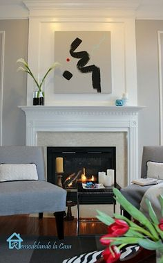 Fireplace ideas  @southernhospitalityblog.com I'm not sure about the top design, but I like the neutral tiles.