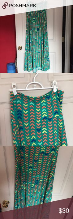 Green Lularoe tube dress or maxi skirt Can be worn as a cover up, strapless dress or high waisted skirt. Green with arrow pattern and has a slight hi lo on the bottom. I bought this from a party my sister had and I haven't worn it. I don't know the name of it. LuLaRoe Dresses High Low