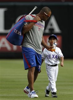 "Adrian Beltre with Adrian Jr. It's ""Baby Precious"" How cute!!! =)"