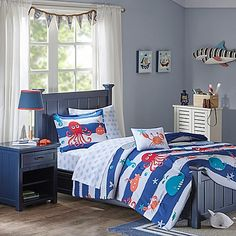 Magical sea creatures frolic on the blue and white nautical stripes of this Mi Zone Kids Sealife Comforter Set to delight and lull your child to sleep. Featuring matching pillow sham(s), whale patterned sheets, and a smiling crab throw pillow.