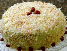 Bobby Flay's Throwdown Toasted Coconut Cake with Coconut Filling and Coconut Buttercream from NoblePig.com