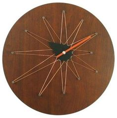 A clock with string-and-nail art is a winner