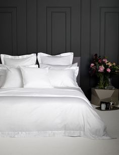 So luxurious, you won't be able to leave your bed - 100% Cotton (50% Egyptian Cotton). Hotel style bedroom decor with luxury white bed sheets and dark grey walls painted with luxury Little Greene paint.