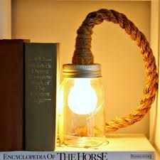 how to cover wire with rope: Vintage Prairie Style: DIY mason jar rope light. Maybe idea for outside patio light Pot Mason Diy, Mason Jar Crafts, Mason Jar Lighting, Mason Jar Lamp, Creation Deco, Jar Lights, Lampe Led, Home Lighting, Cottage Lighting