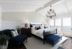 classic navy master bedroom | The master bedroom takes your breath away with the incredible ocean ...