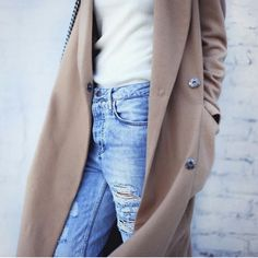 Camel coat & ripped jeans.