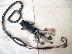 Clapperdudgeon. Metaphysical Tribal Assemblage Necklace with recycled Hardware and Indian Fabric Stamp.