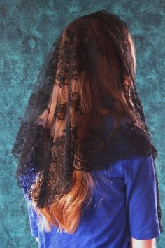 Available in black, white, off-white, gray, navy, purple, old gold, cream yellow, rose, sky blue, ocean blue, black & silver, black & gold, and black & green, this elegant embroidered mantilla comes directly from Barcelona, Spain. It is a very popular chapel veil for its lovely drape and artful embroidery.