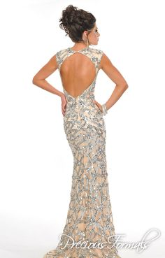 Come try on this stunning nude and silver dress! It also comes in Royal for special orders. P8939