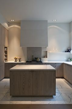 Minimal kitchen...love how the hood was done.