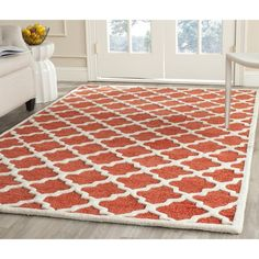 Safavieh Handmade Precious Rose Polyester/ Wool Rug ($159) ❤ liked on Polyvore featuring home, rugs, pink, contemporary rugs, wool area rugs, safavieh rugs, pink area rug and modern contemporary rugs