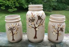 Set of 3 Hand Painted and Embellished Tree Mason Jars. Birds and Flowers adorn the hand painted trees on these shimmering pale beige jars Bottle Painting, Bottle Art, Bottle Crafts, Painting Glass Jars, Glass Bottle, Mason Jar Art, Mason Jar Gifts, Painted Jars, Painted Trees