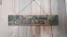 A she who dares winssign handpainted on reclaimed wood,  measures approx 30cm  I use various paints and stains to create unique effects on my signs so each is truly individual.  Please note as all of my upcycled pieces are made from reclaimed and vintage items you may see signs of wear and tear this does not affect the integrity of the piece and all adds to the charm of a bespoke upcycled piece of home decor, | Shop this product here: http://spreesy.com/forestfurnishings/105 | Shop all of…