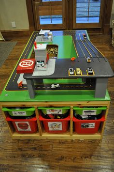 DIY car table made from Ikea units & MDF. already have a train table, we could just paint this on one side and add the ramp. cool!