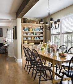 Farmhouse Dining Room. beam chandelier hutch