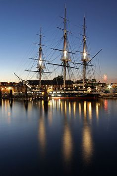 Boston Night Photography image of the historic USS Constitution battleship, also known as Old Ironsides, mooring in the Charlestown Navy Yard in historic Boston, Massachusetts. Fireworks going of to the right of the boat. The Bunker Hill Monument on Breed's Hill is the end of the Boston Freedom Trail.   My best,   Juergen  www.RothGalleries.com