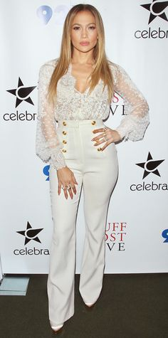 Jennifer Lopez was white-hot at a 92nd Street Y talk in a sheer cross-front guipure lace top with white sailor pants, both by Zuhair Murad, styling her look with EFFY Jewelry rings on practically every single digit and a gold Hayward box clutch.