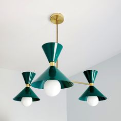 Mid Century Modern inspired chandelier in emerald green and brass.  Perfect for dining rooms, bedrooms, and more.  Great for eclectic and boho design. Bathroom Chandelier, Modern Chandelier, Chandeliers, Monochrome Interior, Modern Interior, Interior Design, Baby Boy Nursery Decor, Nursery Design, How To Make Decorations