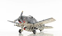 """CaptJimsCargo - Grumman F6F Hellcat Fighter Aircraft Metal Model 12"""" WWII Airplane, (http://www.captjimscargo.com/metal-model-airplanes-helicopters/grumman-f6f-hellcat-fighter-aircraft-metal-model-12-wwii-airplane/) The missiles, bombs, drop tank and landing gear are welded into position (no parts are glued on)."""