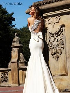 The back is the most beautiful dress I've ever seen look at the detail!