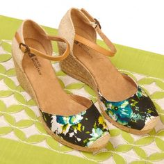 White Mountain Shoes Mamba Black Floral Wedge Woven rope wedge with rope sole. Stripy canvas fabric with solid heel fabric. Ankle strap with buckle. Online Exclusive! Back by Poplar Demand and in a dazzling array of colors! Take your summer look to new heights in these vacation ready wedges.