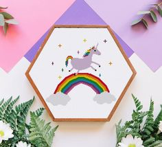 Modern cross stitch patterns and kits for DIY projects by Ritacuna Unicorn Cross Stitch Pattern, Cross Stitch Art, Counted Cross Stitch Kits, Cute Rainbow Unicorn, Cute Unicorn, Modern Cross Stitch Patterns, Cross Stitch Designs, Diy Nursery Decor, Nursery Ideas