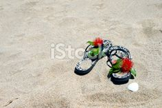Kiwiana Christmas; Jandals in the Sand with Pohutakawa Royalty Free Stock Photo