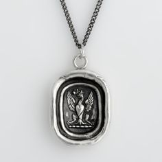 This handcrafted talisman necklace features an eagle with wings spread, which is symbolic of the freedom obtained by following your dreams. The rose signifies the passion that is ignited by doing what you were meant for.