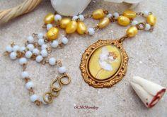 https://www.etsy.com/listing/156485237/sale-glass-fairy-cabochon-pearl-agate?ref=pr_shop