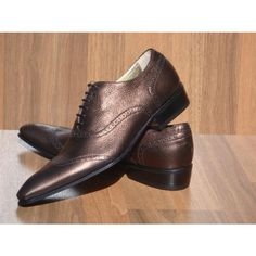 Exclusive shoes made of manufactured leather, bronze color