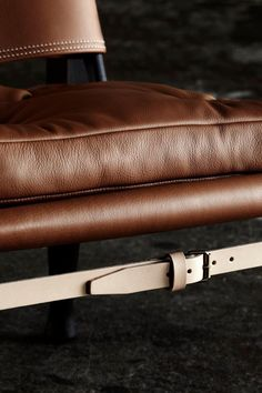 The simple strap in durable saddle leather under the seat of the safari Chair gives the chair strength and stability. Details of Kaare Klint´s design gem, The Safari Chair from 1933.