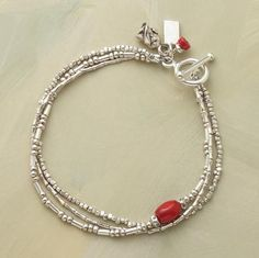"SILVER THREE WAYS BRACELET -- Three strands of Thai silver beads are set off with coral embellishments and a rosebud charm. Sterling silver toggle clasp. Handmade in USA. 7-1/2""L."