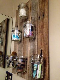 I made this! Its great for keeping my makeup organized! :) You can find this in my Etsy store. Rustic Mason Jar Organizer by RusticBluegrass on Etsy, $75.00