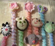 Crocheted dummy clips. Characterful animal, insect or flower attached to a crocheted spiral. The dummy is attached to the clip via the ribbon/butt ...