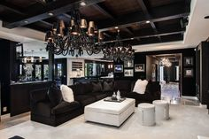 Khloe Kardashian House Decor Contemporary Living Room with Storage Ottomans in Orange County by Orange Coast Interior Design