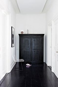 Black floors, armoire