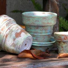 DIY antique pots - just layer terra cotta pots in different shades & slowly sand off by hand til you get the look you want.