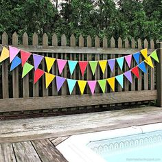 Colorful Outdoor Wood Bunting -- String together simple wood bunting to create fun, outdoor decor. #decoartprojects #patiopaint